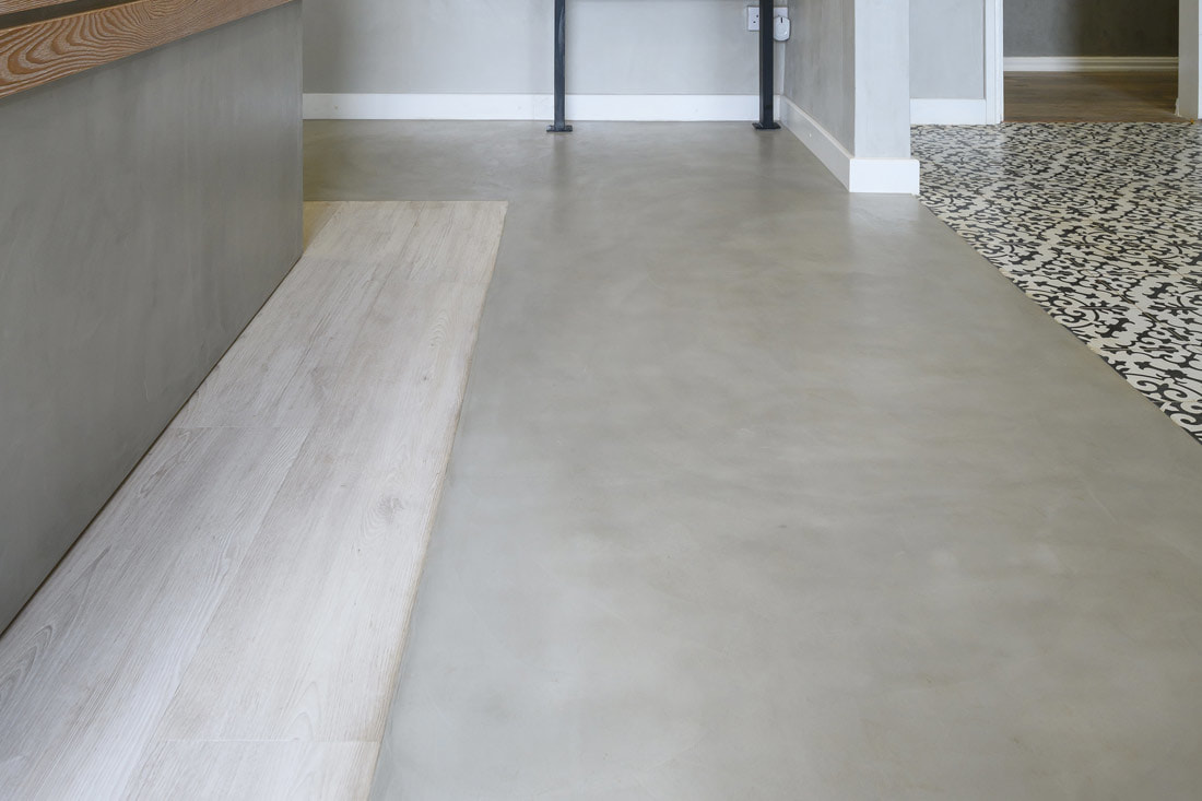Cemcrete CreteCote Grey floor with wood and tile inlays